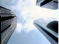 Photo looking up through tall buildings
